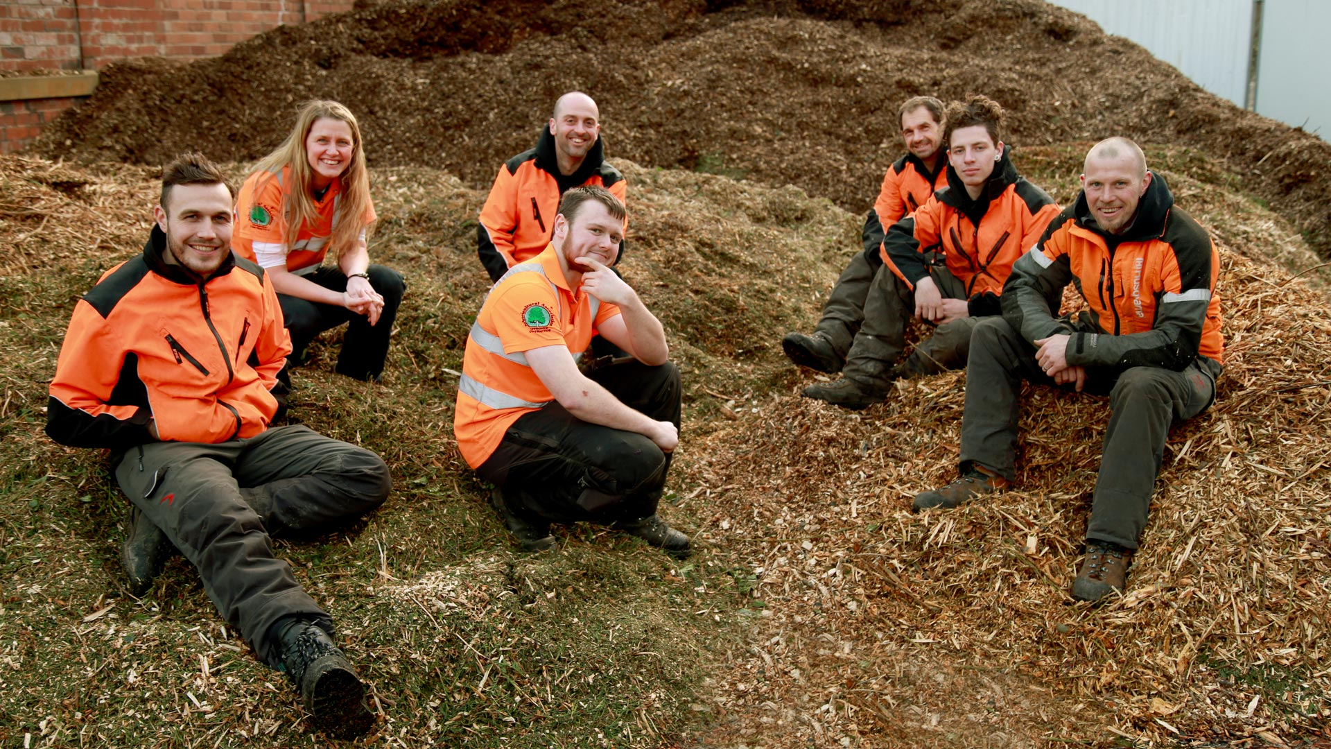 The ACME ARB team on a mountain of woodchippings